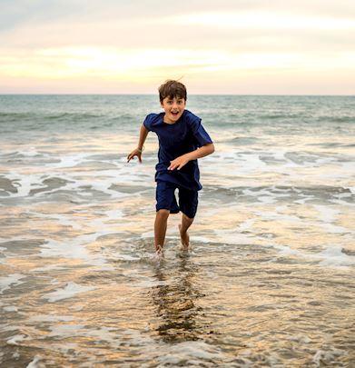 boy on the beach nuevo vallarta