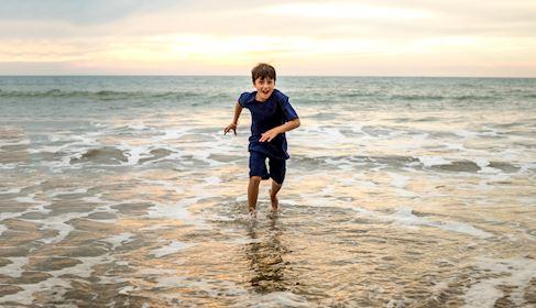 kid on the beach nuevo vallarta
